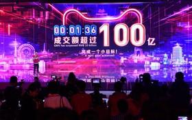 """零時鐘聲剛過去1分36秒,2019天貓""""雙11""""成交額已突破100億元人民幣。(圖源:新華社)"""