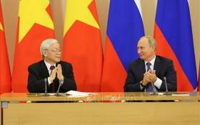 黨中央總書記、國家主席阮富仲(左)與俄羅斯總統普京。(圖源:越通社)