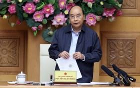 政府總理阮春福主持政府常務處關於責成國家財政預算給國家鐵路落實基礎設施結構保修、管理事宜的會議。(圖源:越通社)