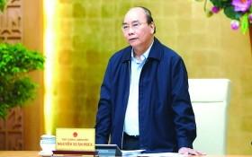 阮春福總理在會上發言。(圖源:光孝)