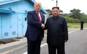 2019年6月30日,在板門店軍事分界線,美國總統特朗普(左)與朝鮮國務委員會委員長金正恩會面。(圖源:AAP)
