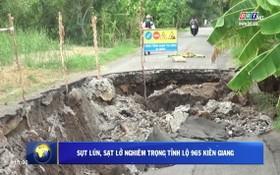 965號省路坍塌、破裂路段長逾50米、最深逾2米,全部路面破裂,導致各類車輛無法行駛。(圖源:視頻截圖)