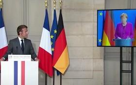 法國總統馬克龍與德國總理默克爾的視頻會議。(圖源:視頻截圖)