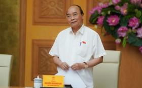 政府總理阮春福會上致詞。(圖源:光孝)