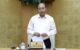政府總理阮春福在會上發表講話。(圖源:統一)