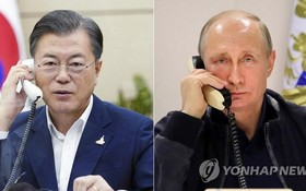 9月28日,在青瓦台,韓國總統文在寅(左)同俄羅斯總統普京通電話。(圖源:韓聯社)