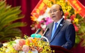 政府總理阮春福在大會上致詞。(圖源:光孝)