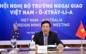 外交部長范平明與澳大利亞外交部長佩恩以視像模式共同主持第二次越澳外交部長年度會議。(圖源:林慶)