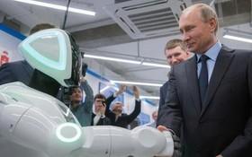 俄羅斯總統普京和 Promobot 機器人握手。(圖源:Sputnik)