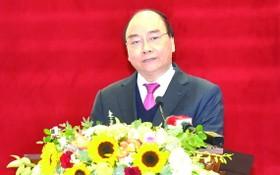 政府總理阮春福在會上發表指導意見。(圖源:VGP)