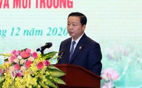 資源與環境部長陳紅河在會上發表講話。(圖源:春龍)