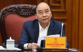 政府總理阮春福主持政府常務處會議。(圖源:光孝)