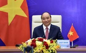 國家主席阮春福在河內以視頻方式出席領導人氣候峰會並發表重要演講。(圖源:越通社)