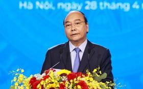國家主席阮春福在會議上致詞。(圖源:統一)