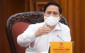 政府總理范明政在會上發表講話。(圖源:VGP)