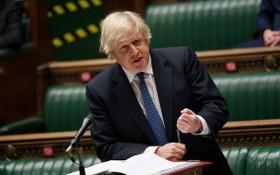圖為2021年3月10日,英國首相約翰遜出席下議院會議。(圖源:路透社)