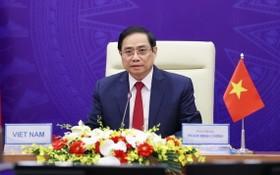 政府總理范明政會上發言。(圖源:越通社)