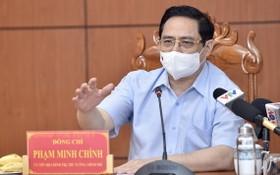 政府總理范明政在會議上發表講話。(圖源:VGP)