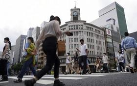 東京、大阪、北海道等9個都道府縣解除緊急事態宣言後,將改為實施防止疫情蔓延等重點措施。(圖源:AP)