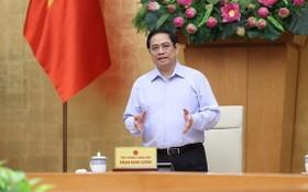 政府總理范明政在會議上發表指導意見。