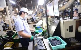 企業若滿足安全防疫條件便獲准恢復生產。