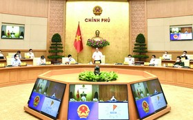 政府總理范明政主持政府例行會議。(圖源:VGP)