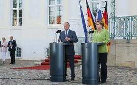 """俄羅斯總統普京曾多次訪問德國,與德國總理默克爾就""""北溪2號""""天然氣管道項目等問題進行討論。 (新華社)"""