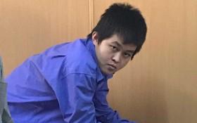 李明日被告在被延緩的複審法庭上。