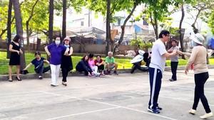 Elder people dance in amusement parks