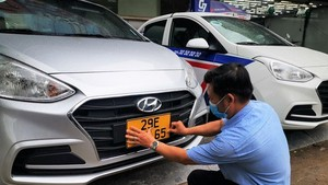 HCMC changes yellow license plates for over 31,000 business vehicles