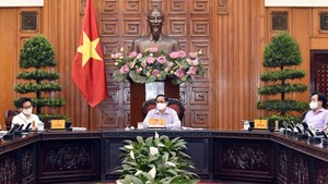 Prime Minister Pham Minh Chinh is delivering his speech in the meeting with MIC. (Photo: SGGP)
