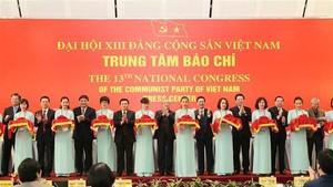 Delegates cut ribbon to inaugurate press centre serving 13th National Party Congress (Photo: VNA)