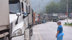 A long line of trucks queuing to go through Tan Thanh Border Gate in the northern province of Lang Son