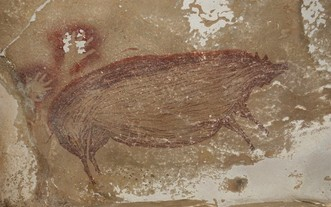 這幅壁畫繪製了野豬畫像,塗上了深紅色赭色顏料。(圖源:互聯網)
