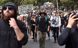 當地時間9月18日,墨爾本約700名反封鎖示威者越過一些封鎖線,在市內幾個地點聚集。 (圖源:AFP)