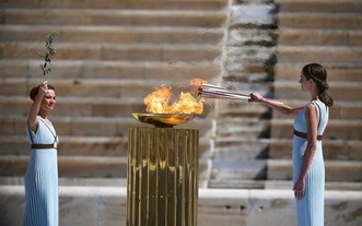 2020年3月19日,東京奧運會聖火採集、交接儀式在泛雅典體育場舉行。(圖源:新華社)