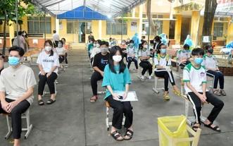 學生在接種前進行篩查。