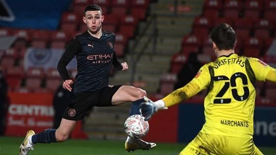 Phil Foden tiếp tục bén duyên ghi bàn để gúp Man.City vượt khó. Ảnh: Getty Images