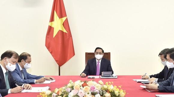 Thủ tướng Chính phủ Phạm Minh Chính điện đàm với Thủ tướng Thái Lan Prayut Chan-o-cha. Ảnh: VIẾT CHUNG