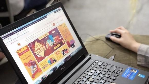 Phiên Chợ tết hàng Việt Nam chất lượng cao là phiên chợ online đầu tiên của Sàn thương mại điện tử hàng Việt Nam chất lượng cao. (Ảnh: Mỹ Phương/TTXVN)