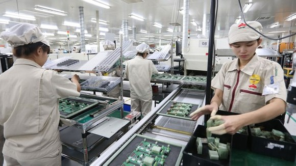 Electronic product manufacturing at UMC Vietnam Company in Hai Duong Province. (Photo: SGGP)