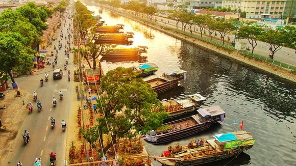 Boats filled with ornamental trees and flowers gather at Binh Dong wharf.