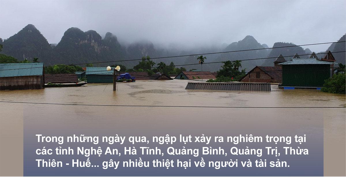 Miền Trung oằn mình trong bão lũ ảnh 1