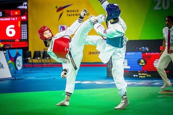 Trương Thị Kim Tuyền (trái) sẽ sang Kazakhstan tập huấn chuẩn bị tranh vé Olympic.