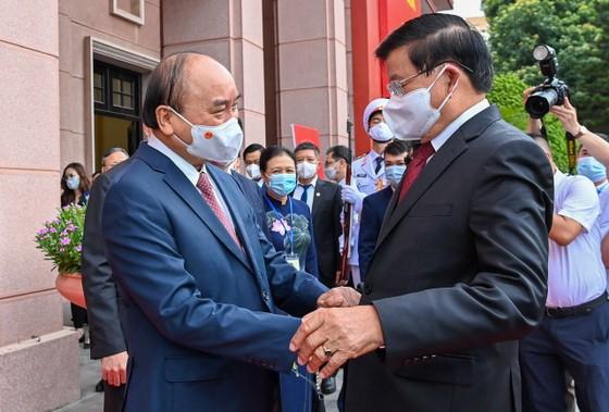 Cùng nhau bảo vệ thành quả cách mạng, phát triển đất nước, giữ gìn quan hệ đặc biệt Việt - Lào đời đời bền vững ảnh 1