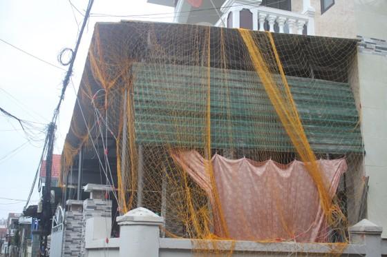 Giăng lưới, cột dây chằng chống nhà cửa ứng phó bão số 10 ảnh 3