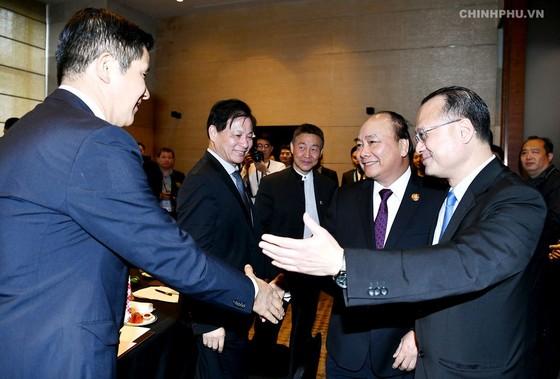 政府總理阮春福會見中國國家主席習近平 ảnh 1