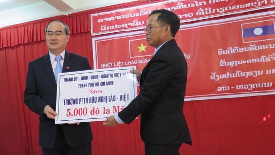 TPHCM hỗ trợ Thủ đô Viêng Chăn về giáo dục ảnh 4