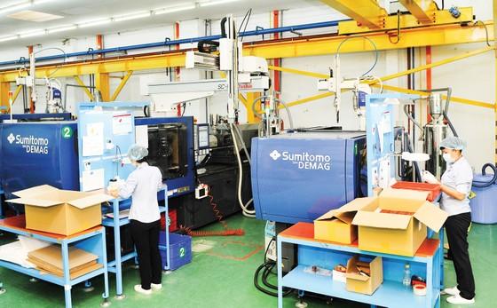 Sản xuất sản phẩm nhựa kỹ thuật cao tại Tổng công ty Công nghiệp Sài Gòn. Ảnh: CAO THĂNG