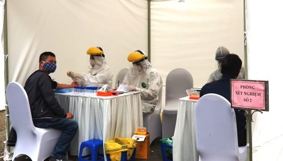 Xét nghiệm hơn 17.900 người từ vùng dịch ở Hải Dương, Quảng Ninh về Hà Nội ảnh 1
